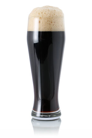 dark beer: Dark beer in a glass with foam, isolated on a white