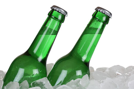 bottles of beer: Beer bottles on ice cubes, isolated on a white  Archivio Fotografico