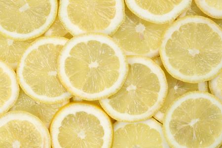 감귤류의 과일: 얇게 썬 레몬 감귤류 과일에서 만든 배경