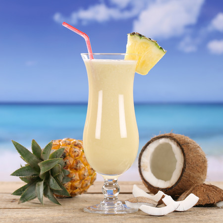 pineapple  glass: Pina Colada cocktail drink with fruits on the beach