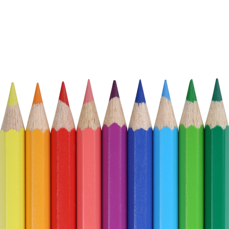 colored school: School supplies colored pencils in a row with copyspace, isolated on a white background