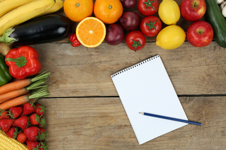 shopping list: Shopping list with fruits and vegetables like oranges, apples and tomatoes