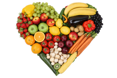 Fruits and vegetables forming heart love topic and healthy eating, isolated photo