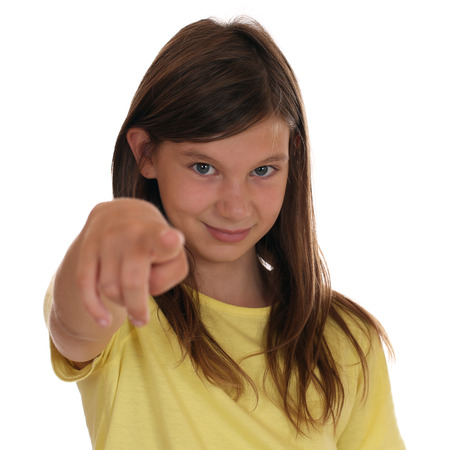 Young girl pointing with her finger I want you, isolated on a white background photo