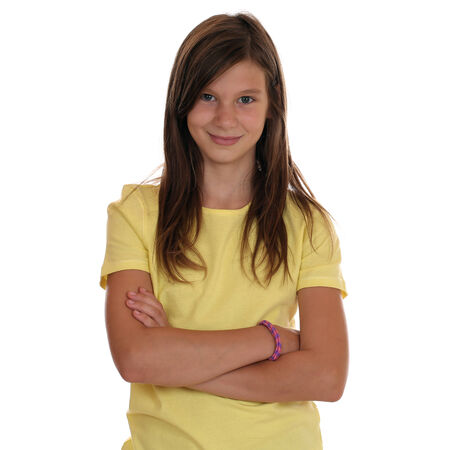 Young teenager girl portrait with folded arms, isolated on a white background Stock Photo