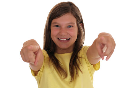 Smiling young girl pointing with her finger I want you, isolated on a white background photo