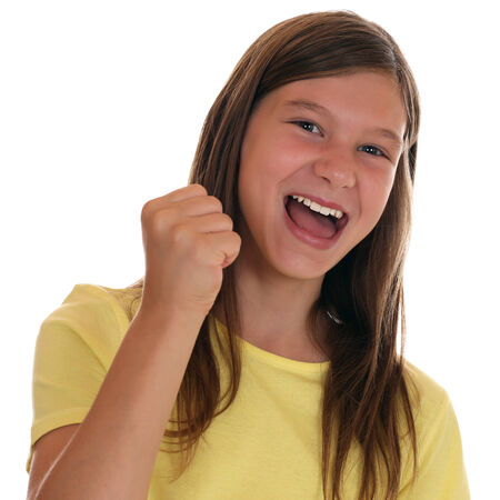 clenching fists: Successful girl clenching fist when winning, isolated on a white background