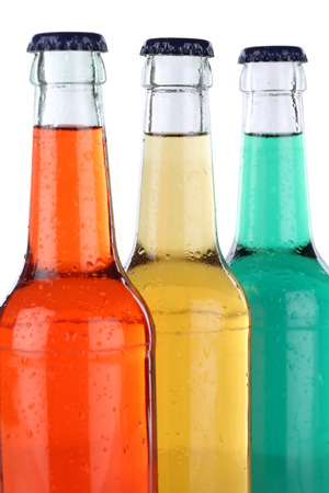 soft drinks: Soft drinks with lemonade in bottles, isolated on a white background Stock Photo