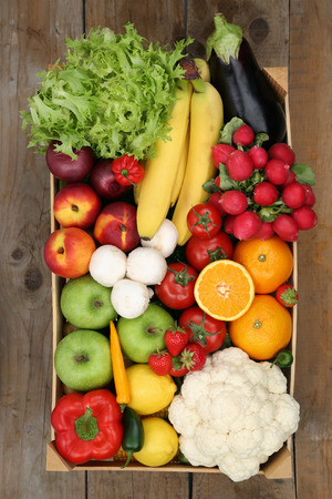 Healthy eating shopping at market fruits and vegetables in box from above