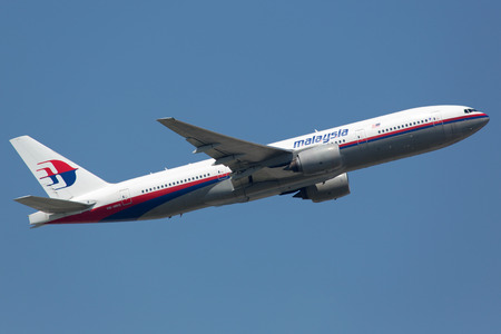Frankfurt, Germany - June 19, 2013: A Malaysia Airlines Boeing 777-200 with the registration 9M-MRG takes off from Frankfurt Airport (FRA) in Germany. This aircraft is the sister airplane of the crashed planes wiith the registration 9M-MRO and 9M-MRD.