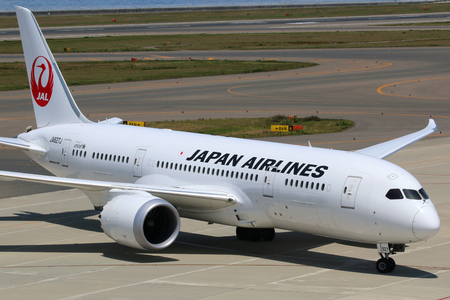 ngo: Nagoya, Japan - May 23, 2014: A Japan Airlines Boeing 787 Dreamliner with the registration JA827J taxis at Nagoya Airport (NGO) in Japan. The Boeing 787 Dreamliner is the worlds first major airliner to use composite materials in the construction of its a
