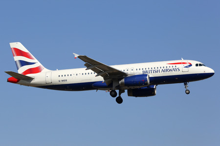 airways: Lisbon, Portugal - July 20, 2013: A British Airways Airbus A320 with the registration G-MIDS on approach to Lisbon Airport (LIS). British Airways is the flag carrier airline of the United Kingdom with its main hub at London Heathrow Airport.