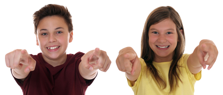 Young teenager or children pointing with finger I want you, isolated on a white background photo