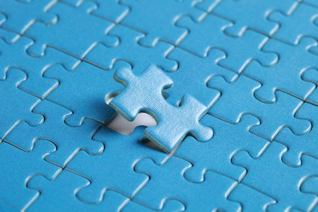The missing piece of puzzle, success, teamwork and finishing or ending Archivio Fotografico