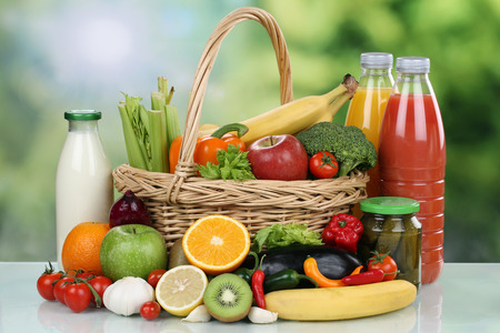 shopping basket: Fruits, vegetables, groceries and beverages in a shopping basket