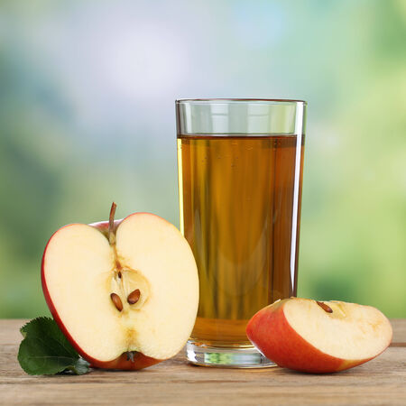 Healthy apple juice drink and red apples fruits in autumn