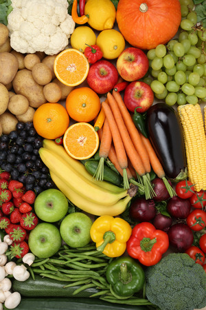 Vegetarian fruits and vegetables like apple, orange and tomato background