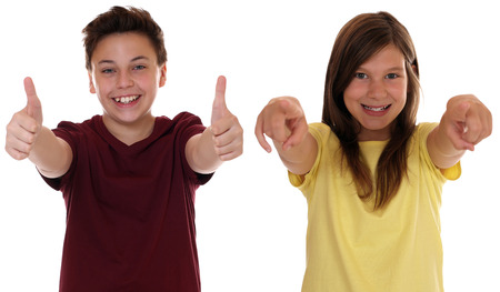 Successful winning smiling children showing thumbs up photo