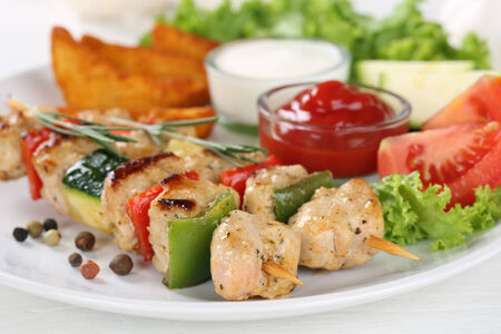chicken salad: Chicken meat skewers meal with potatoes, vegetables and lettuce on a plate