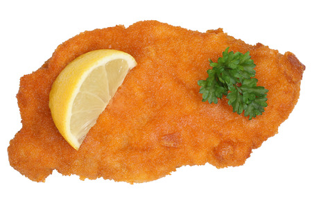 Schnitzel chop cutlet with lemon isolated on a white background Foto de archivo