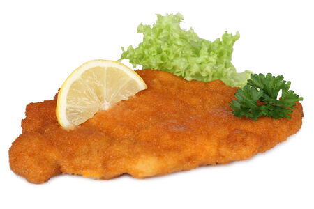 Schnitzel chop cutlet with lemon and lettuce isolated on a white background 免版税图像