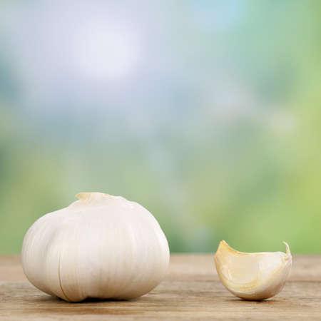 garlic clove: Fresh garlic clove vegetables in summer on a wooden board