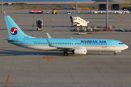 ngo: Nagoya, Japan - May 23, 2014: A Korean Air Boeing 737 with the registration HL8242 taxis at Nagoya Centrair Airport (NGO) in Japan. Korean Air is the largest airline in South Korea. It is headquartered in Seoul und operates with 148 aircraft.