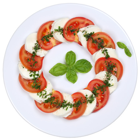 caprese salad: Caprese salad with tomatoes and mozzarella cheese from above isolated on a white background Stock Photo