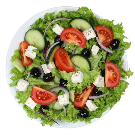 feta: Greek salad with tomatoes, Feta cheese and olives in bowl from above isolated on a white background Stock Photo
