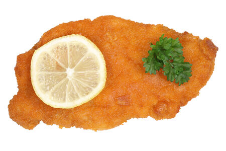 schnitzel: Schnitzel chop cutlet with lemon from above isolated on a white background Stock Photo