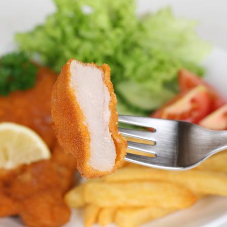 schnitzel: Eating Schnitzel chop cutlet steak with fork