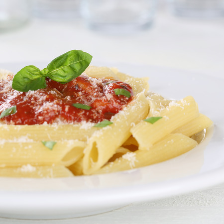 napoli: Penne pasta with Napoli tomato sauce noodles meal on a plate Stock Photo