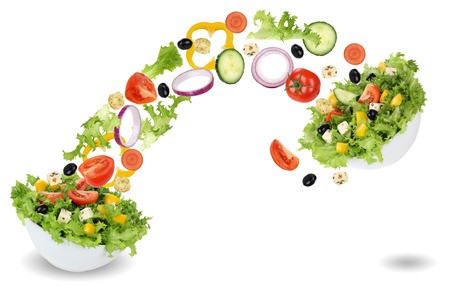 feta cheese: Flying salad ingredients in bowl with tomatoes, lettuce, Feta cheese, onion and olives Stock Photo