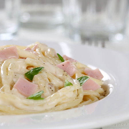 carbonara: Italian Spaghetti Carbonara noodles pasta meal with ham on a plate