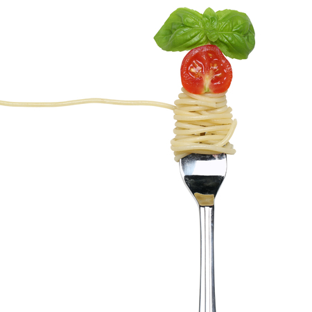 pasta fork: Eating spaghetti noodles pasta on a fork isolated with copy space