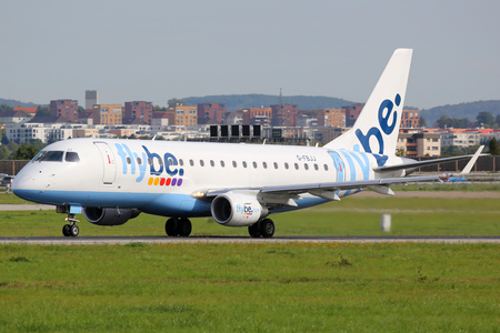 str: Stuttgart, Germany - September 19, 2014: A Flybe Embraer ERJ175 with the registration G-FBJJ takes off from Stuttgart Airport (STR) in Germany. Flybe is a regional airline from Great Britain based in Exeter.