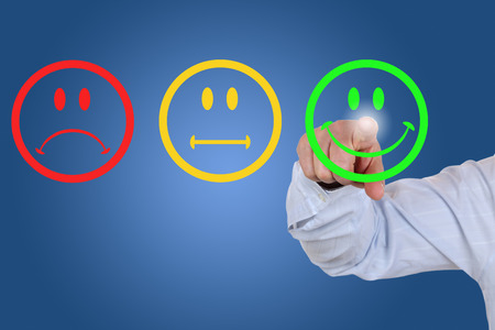 positive positivity: Businessman gives a positive vote for service quality with a green smiley