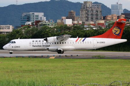 airways: Taipei, Taiwan - May 18, 2014: A TransAsia Airways ATR 72-500 with the registration B-22803 taxis at Taipei Songshan Airport (TSA) in Taiwan. TransAsia Airways is a private airline from Taiwan. Editorial