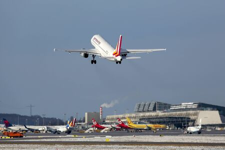 stuttgart: Stuttgart, Germany - January 31, 2015: A Germanwings Airbus A319 with the registration D-AGWI taking off from Stuttgart Airport (STR). Germanwings is a German low-cost airline which is owned by Lufthansa.