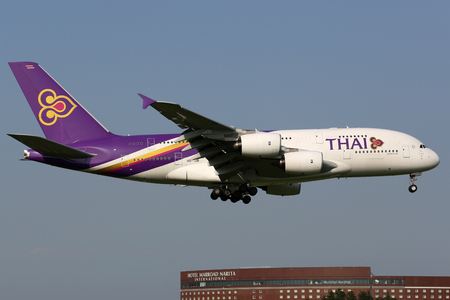 airways: Tokyo Narita, Japan - May 16, 2014: A Thai Airways Airbus A380-800 with the registration HS-TUB approaching Tokyo Narita Airport (NRT) in Japan. Thai Airways is the largest airline in Thailand with its headquarters in Bangkok.