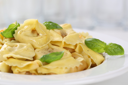 Italian Tortellini pasta noodles meal with basil on plate