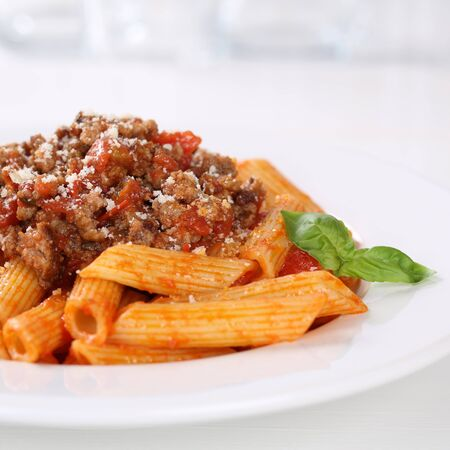 bolognaise: Italian cuisine penne Bolognese or Bolognaise sauce noodles pasta meal on a plate Stock Photo