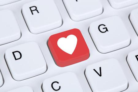 internet dating: Searching partner and love online on digital internet dating computer Stock Photo