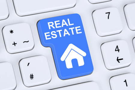 real estate investment: Selling or buying a real estate investment home icon online on the computer Stock Photo