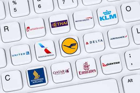 Berlin, Germany - April 7, 2015: Collection of logos of airlines like American, United, Delta, KLM, Lufthansa, British Airways, Qantas, Qatar, Emirates on a computer keyboard.