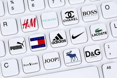 chanel: Berlin, Germany - April 7, 2015: Collection of logos of fashion clothes brands like Adidas, Puma, Nike, Primark, Abercrombie and Lacoste on a computer keyboard.
