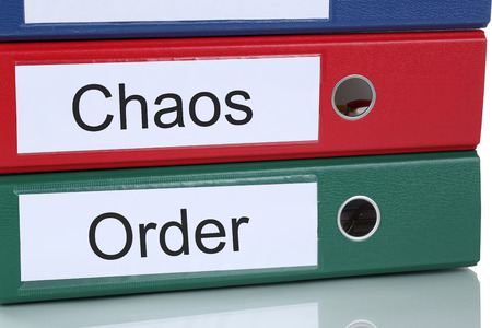 order chaos: Chaos and order organisation mess in office business concept
