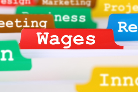 Employee wages and salary financial business concept register in documents Archivio Fotografico