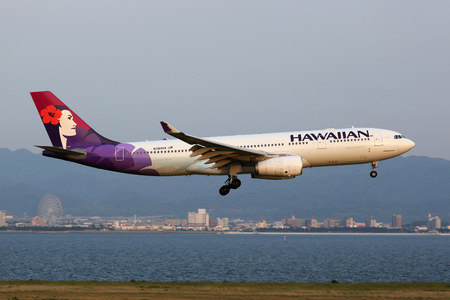 Osaka Kansai, Japan - May 24, 2014: A Hawaiian Airlines Airbus A330-200 with the registration N380HA approaching Osaka Kansai Airport (KIX) in Japan. Hawaiian Airlines is a US airline based in Honolulu, Hawaii. Editöryel