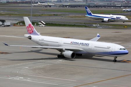 headquartered: Tokyo Haneda, Japan - May 27, 2014: A China Airlines Airbus A330-300 with the registration B-18351 at Tokyo Haneda Airport (HND) in Japan. China Airlines is the flag carrier airline from Taiwan headquartered at Taipei Taoyuan airport. Editorial